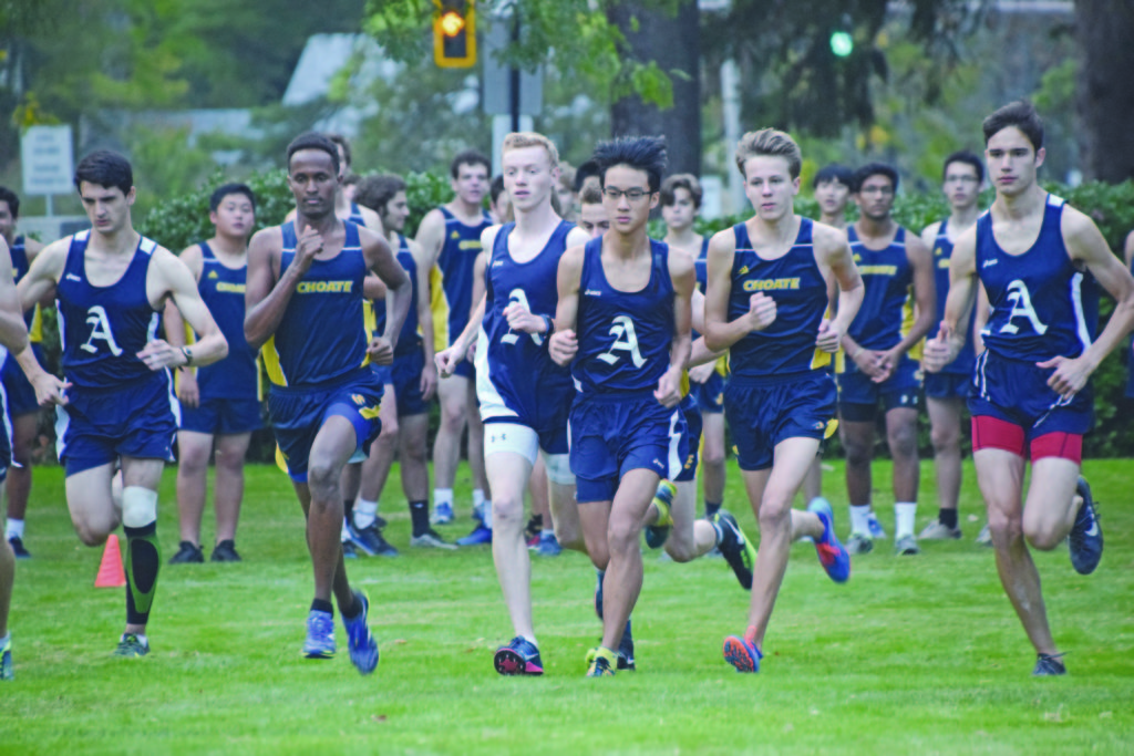 David Cohen '18, Harrison Wilson '20, and Max Yang '20 run in a pack.