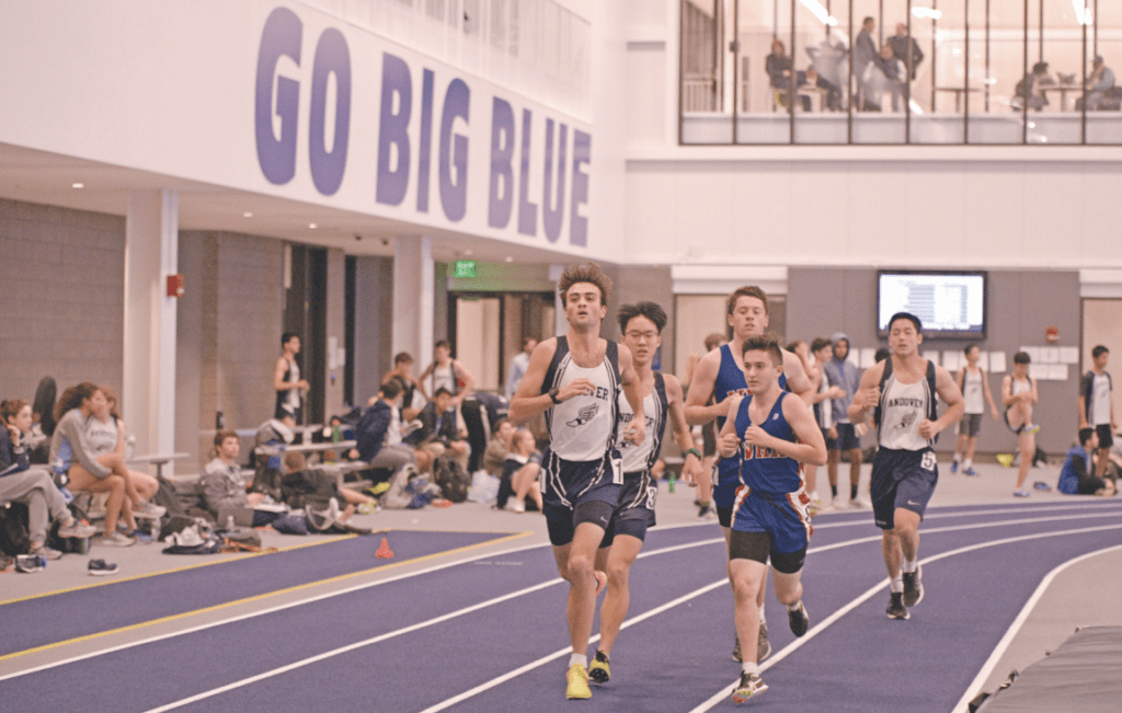 Co-Captain Giacomo Marino '18 leads the pack during Andover Indoor Track & Field's victory in the inaugural meet in the new Snyder Center.