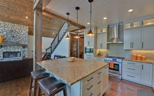 Kitchen island with an overhang providing a seating area.