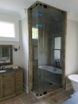 Rustic vanity, tiled shower and soaker tub.
