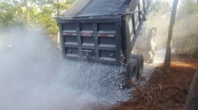 A load of gravel being poured out for the driveway.