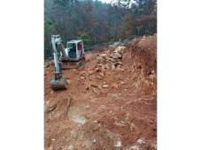 Digging up more rock.