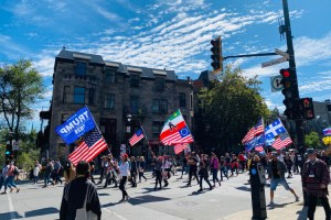 Canadian protesters marching against lockdown orders in Montreal with Trump 2020 flags