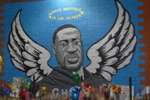 George Floyd angel mural with gifts