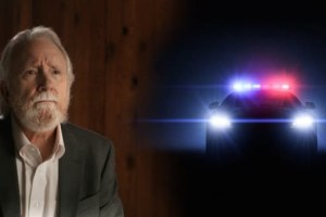 Norm Stamper and police car