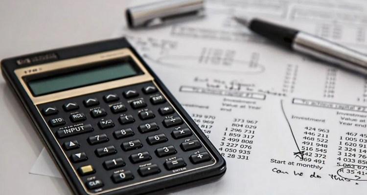 Calculator sitting on tax document