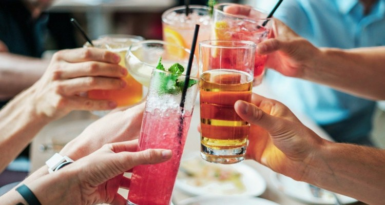 Group cheering with alcoholic drinks