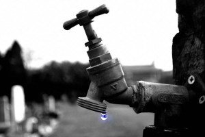 Tap water spout with one blue drop
