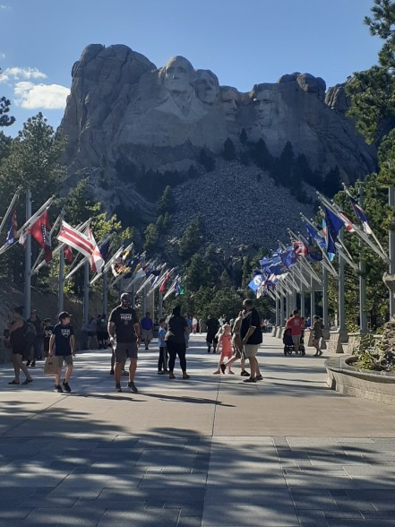 Tourists in front of Mount Rushmore