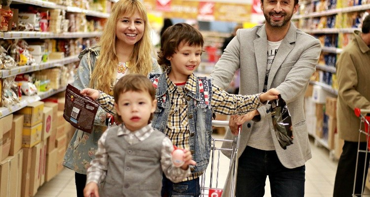 Happy family at grocery store