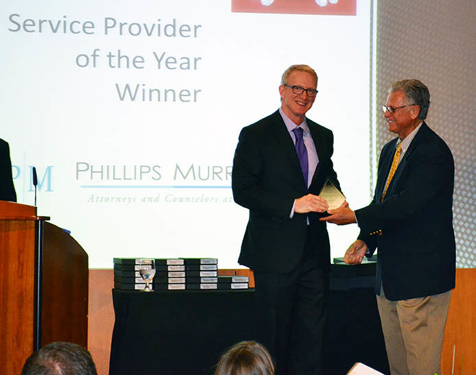 Phillips Murrah Of Counsel attorney, David Walls receives the Service Provider of the Year award at the ASAOK Denim and Diamonda Awards Gala onApril 28, 2015.