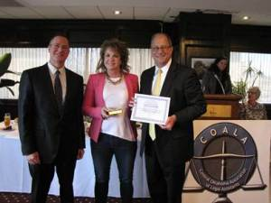 Lisa McAlister accepts the COALA 2015 Paralegal of the Year award from Judges Richard Ogden and Don Andrews.