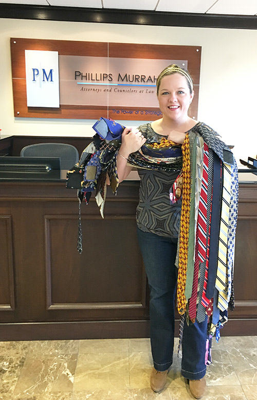 "Journal Record journalist Molly Fleming holds ties donated by Phillips Murrah. She tweeted: ""Just picked up 52 ties from our neighbors @PhillipsMurrah. Thanks, everyone! #tieday"""