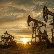 Oil pump jacks with a sunset sky
