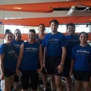 Law & Oarder, Phillips Murrah's rowing team, gets ready to practice before racing in the 2018 Stars and Stripes River Festival.