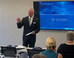 Attorney David Walls addresses construction industry professionals at September's CFMA meeting.
