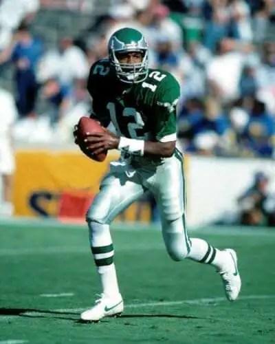 Randall Cunningham, Eagles quarterback scrambling.