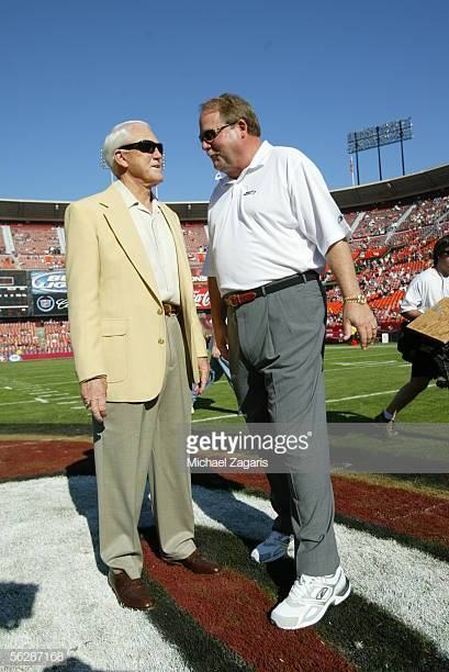 Two iconic NFL coaches, Bill Walsh & Mike Holmgren. talking on the field