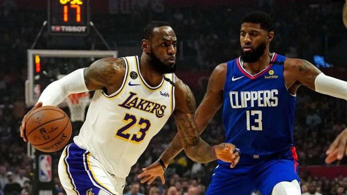 Lebron James and Paul George. 2020 NBA champion asterisk