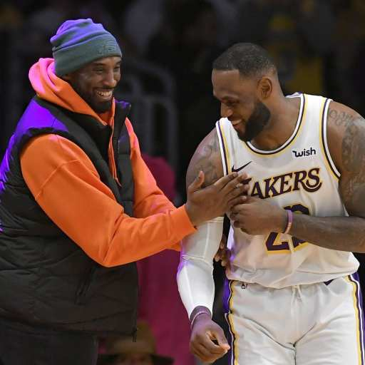 Kobe Bryant jokes with LeBron James during a Lakers game,is leBron better than Jordan?