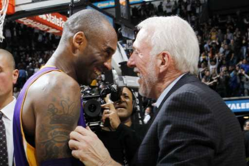 Kobe Bryant and Gregg Popovich greet each other