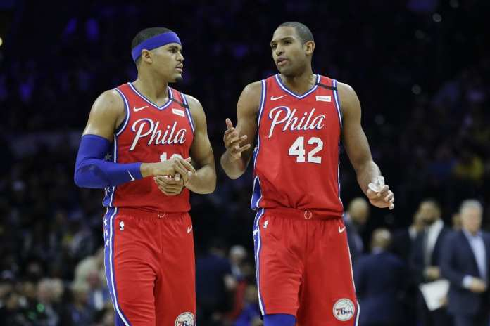 Tobias Harris & Al Horford talking on the court as Sixers