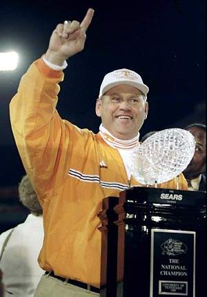 ex-tennessee head coach Philip Fulmer with the BCS Championship trophy in 1999