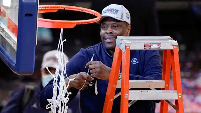 Patrick Ewing cuts down the nets after Georgetown becomes Big East champs in 2021.