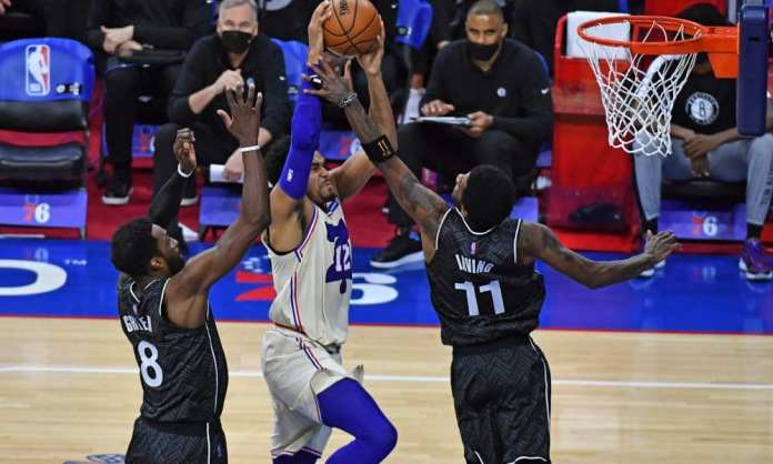 Tobias Harris takes the ball strong to the basket vs the Nets.  Will Brooklyn have enough defense in 2021, for the NBA eastern conference playoffs.