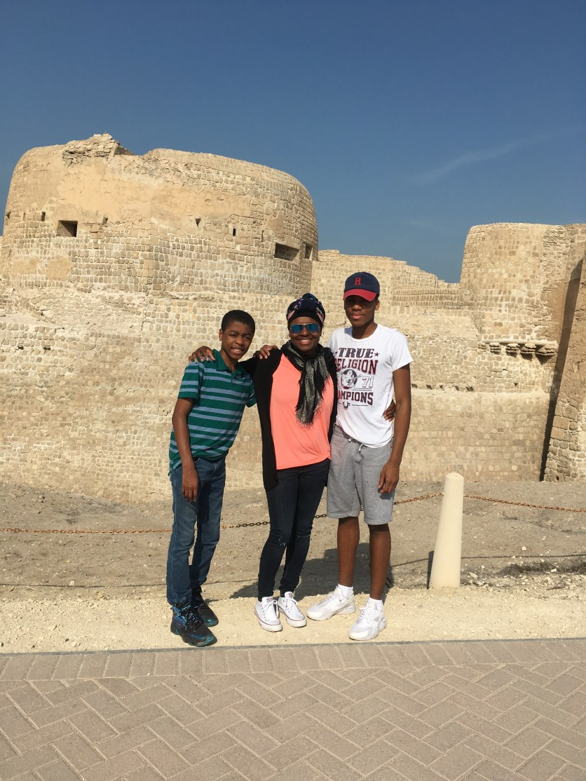 My boys and I in front Qal'at al-Bahrain