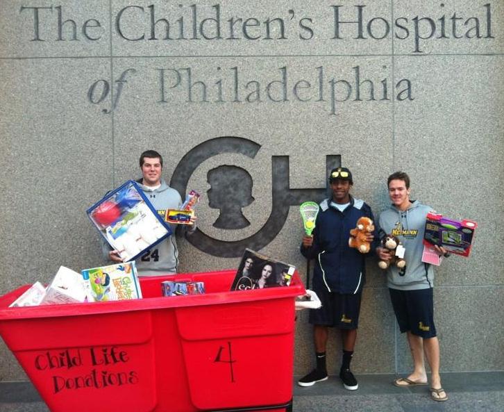 Community service: Neumann men's lacrosse team gives gift of