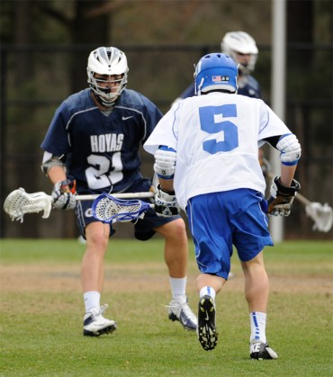 Georgetown's Billy Flatley defends Duke's Tanner Scott during Saturday's 19-7 Duke win. The two players were on back-to-back state championship teams at Conestoga in 2010 and 2011