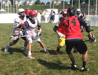 Players work on box lacrosse drills in 3dRising D1 Showcase