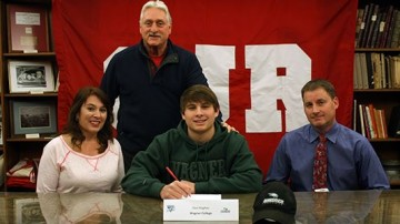 Owen J. Roberts senior Dan Hughes, flanked by parents Patricia and Brian Hughes, signs a National Letter of Intent to Wagner College during a recent ceremony at the high school. Also in attendance at the event was OJR head coach Jeff Neese (standing)