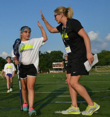 NXT girls' director Kate Henwood kicked off the new program with a high-five