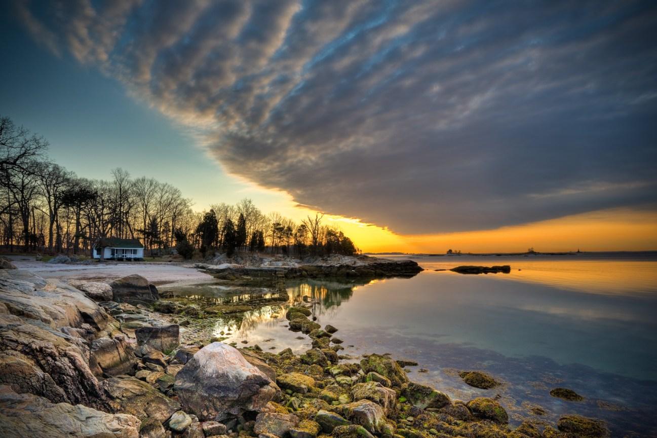 sunrise over rocky coast