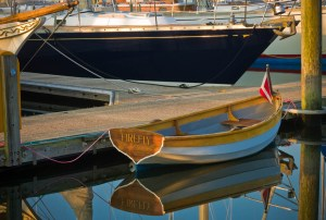 rowboat named firefly at dock