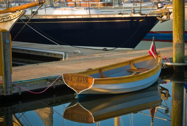 rowboat named firefly at dock