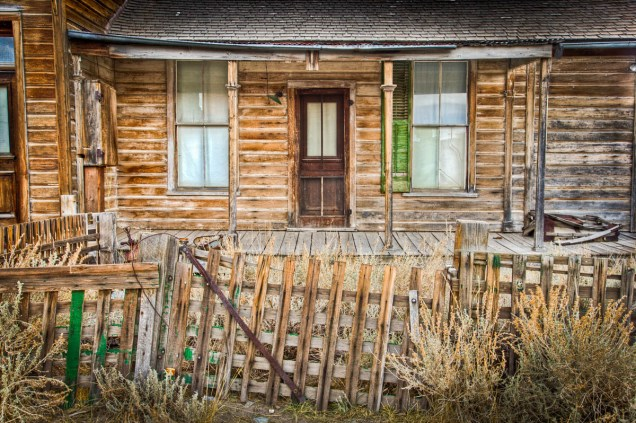 old cabin with green shutter