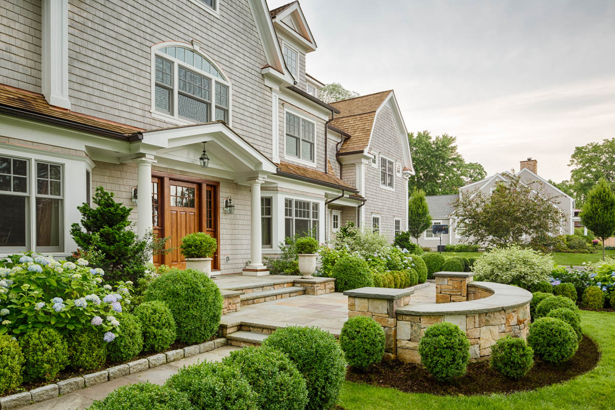 lush landscaping in front of house