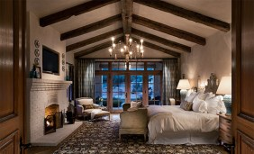 Country-Side-Bedroom-with-Exposed-Roof-beams-on-Chatedral-Ceiling