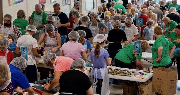 Volunteers prepare meals for Haiti