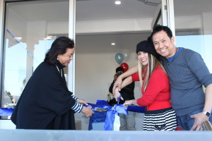 ConGen Gigi Kalong cuts the ceremonial ribbon for the opening of the clinic
