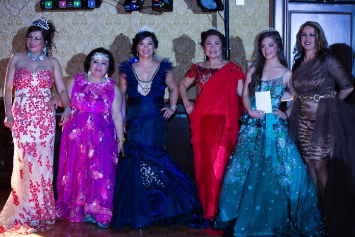 "Winner of the ""Western Union""  Belle of the Ball Sarah Symes (second from right) with Terry Kane, Second Prize winner and Choy Symes, Third Prize winner.  At left is  Norma San Diego-Santos."