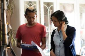 Vonne Patiag (writer/director) and Ala Paredes who plays Justin's mother Esperanza read over the script before a scene. PHOTO: © In-Between Pictures / Christina Mishell