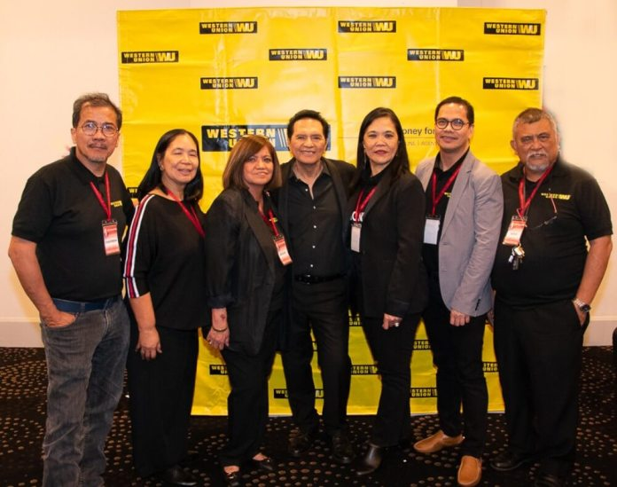 Jun Polistico with organisers of his concert in Sydney