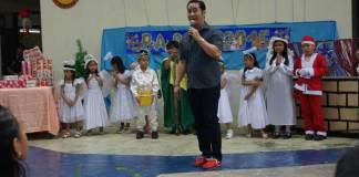 Midel Santos Stokes holds a Christmas gift-giving at Sto Rosario Elementary School