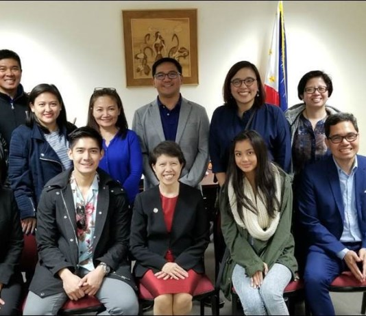 "At the ABS-CBN ""ASAP Live in Sydney"" courtesy call on Philippine Consul General of Sydney Maria Teresa L. Taguiang are, seated from left, Consul Melanie Rita Balisi Diano, Robi Domingo, ConGen Taguiang, Ylona Garcia, and Consul Emmanuel Donato K. Guzman. Standing from left, second row, are ABS-CBN Global Events Operations Head Geraldine Bisquera, ASAP Executive Producer Apple Salas-Segubience, ASAP Business Unit Head Joyce Liquicia, ABS-CBN Global Head of Events Ricky Resurreccion, ABS-CBN Asia Pacific Regional Marketing Head and concurrent Country Manager for South Asia Maribel Hernaez and ABS-CBN Global Head of Corporate Affairs & PR Nerissa Fernandez. Standing from left, third row, are Peter Garcia (Ylona's father) and ABS-CBN Australia Country Manager Jay Santos. (Photo by Ryan Neri/ABS-CBN Corporation)"