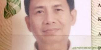 Raine's dad's last passport photo