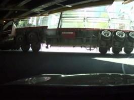 huge truck hitting underpass |
